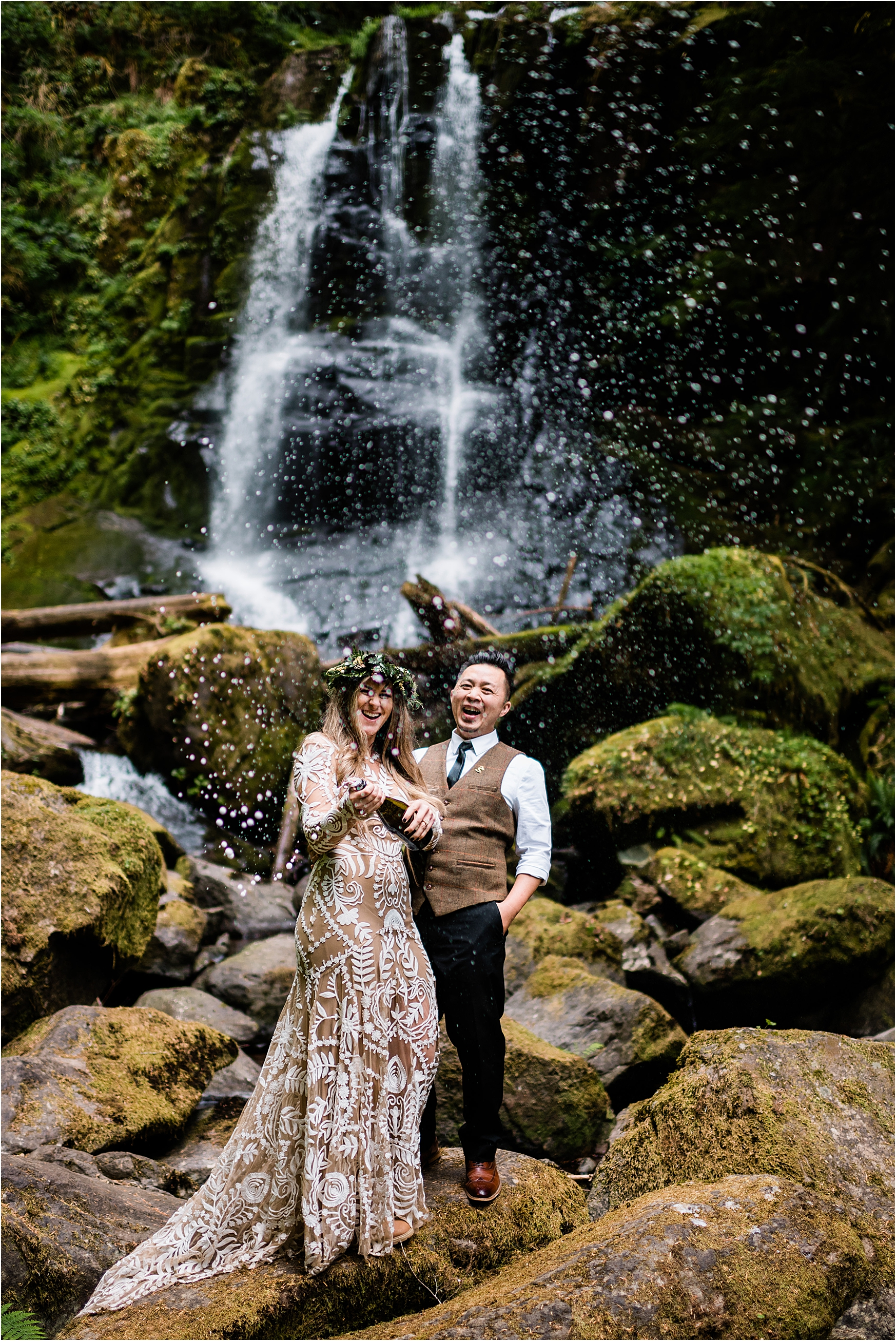 Champagne pop at a waterfall adventure wedding in Oregon. Image by Forthright Photo, Seattle Wedding & Elopement Photographers.