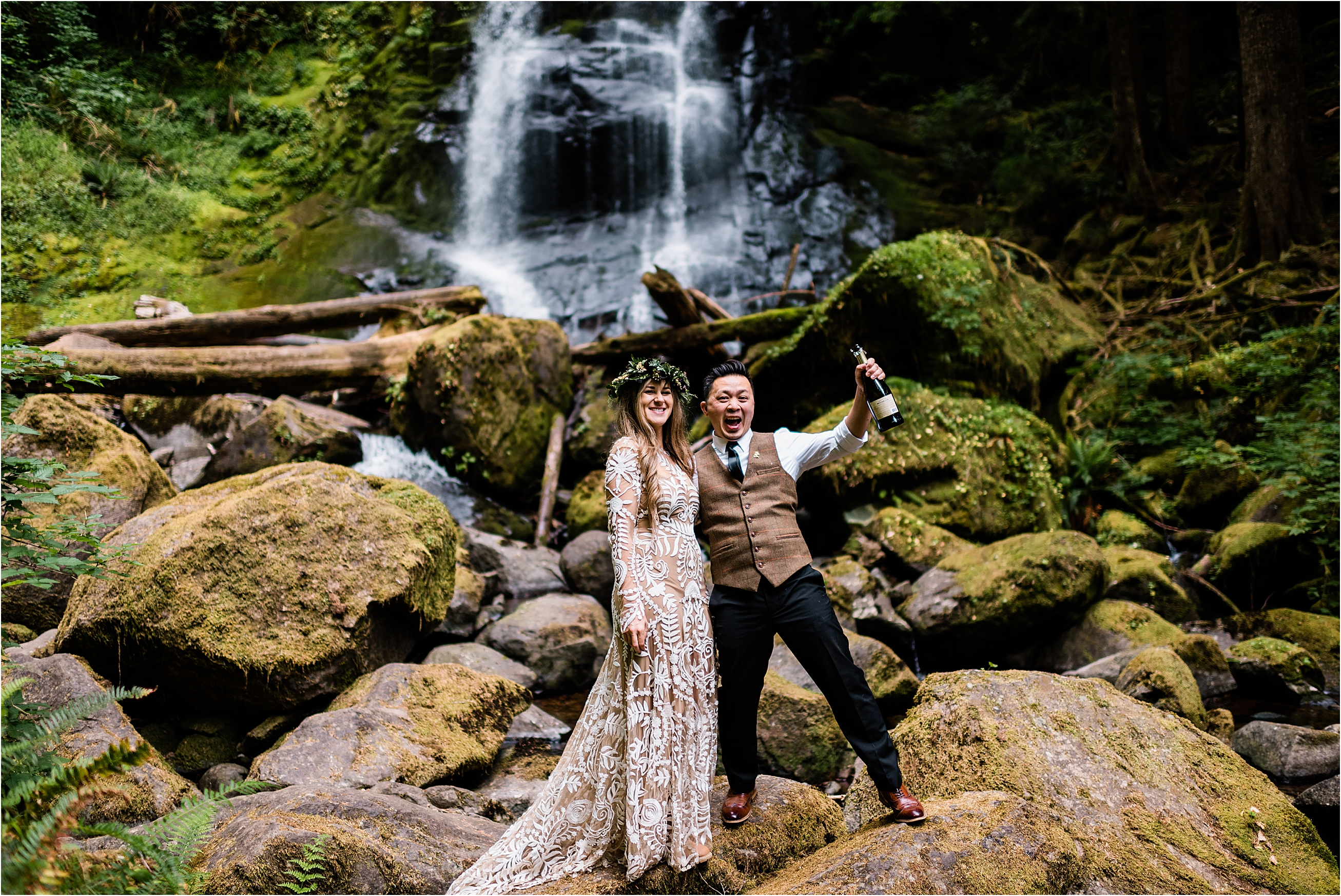 Newlyweds pop champagne at a waterfall adventure wedding in Oregon. Image by Forthright Photo, Seattle Wedding & Elopement Photographers.