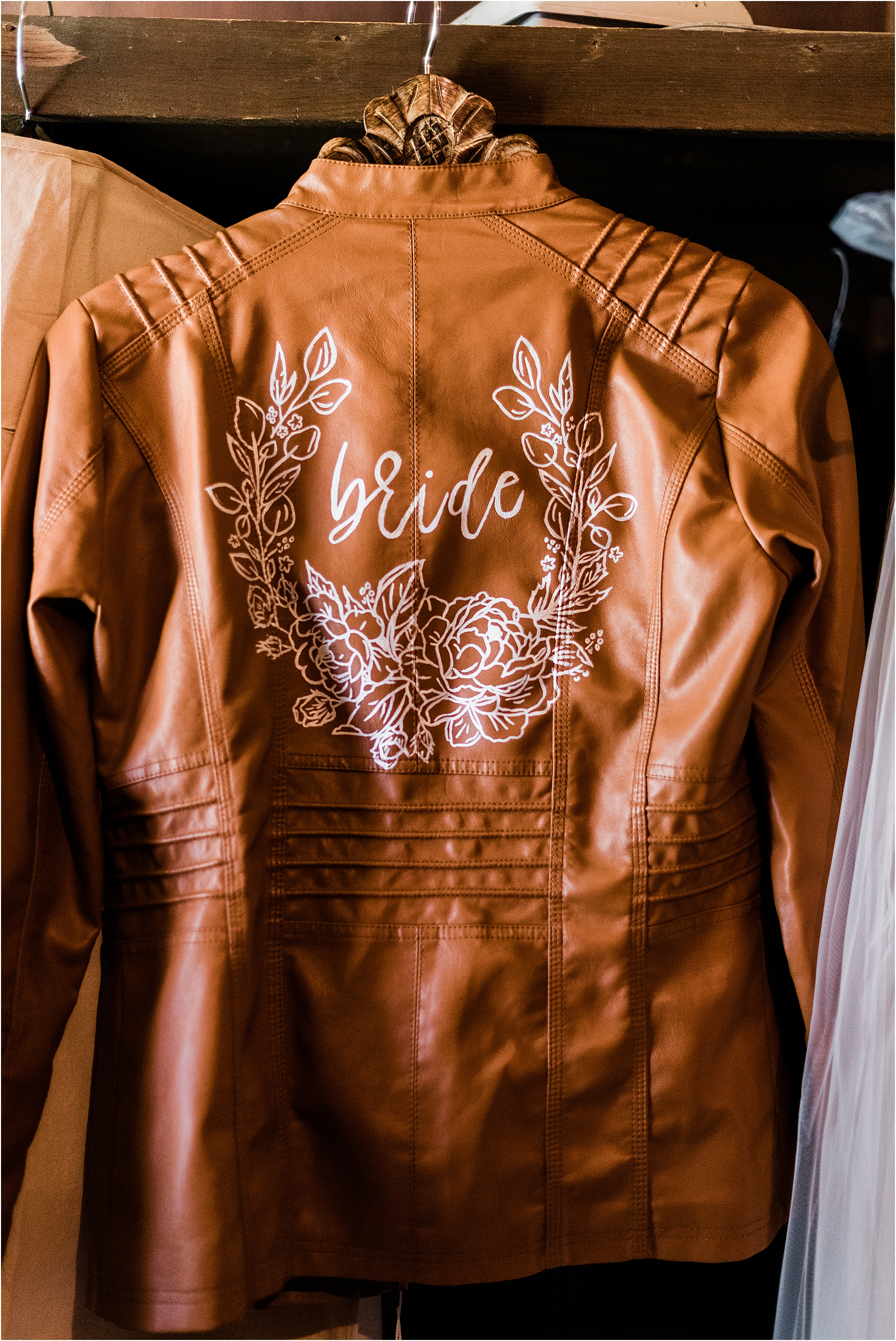 Customized bridal leather jacket with hand-stenciled decal. Image by Forthright Photo.