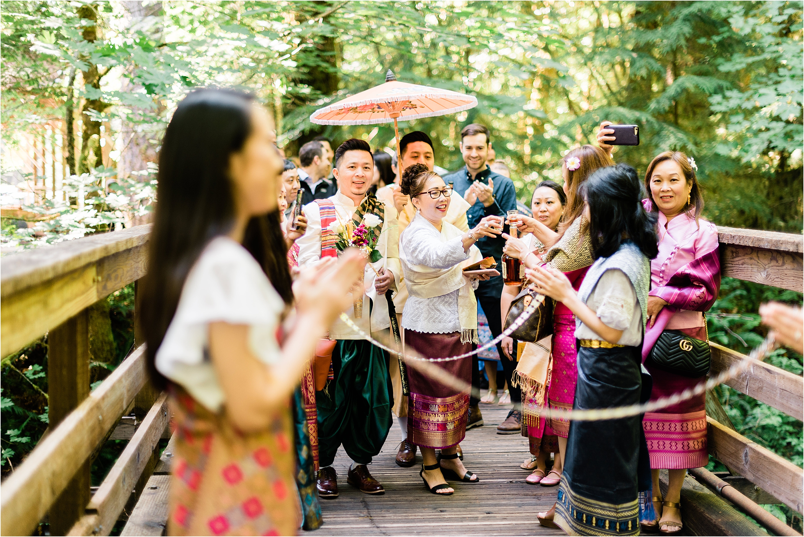 Traditional Laos wedding processional at Camp Lane, Oregon. Image by Forthright Photo, Seattle Wedding & Elopement Photographers.