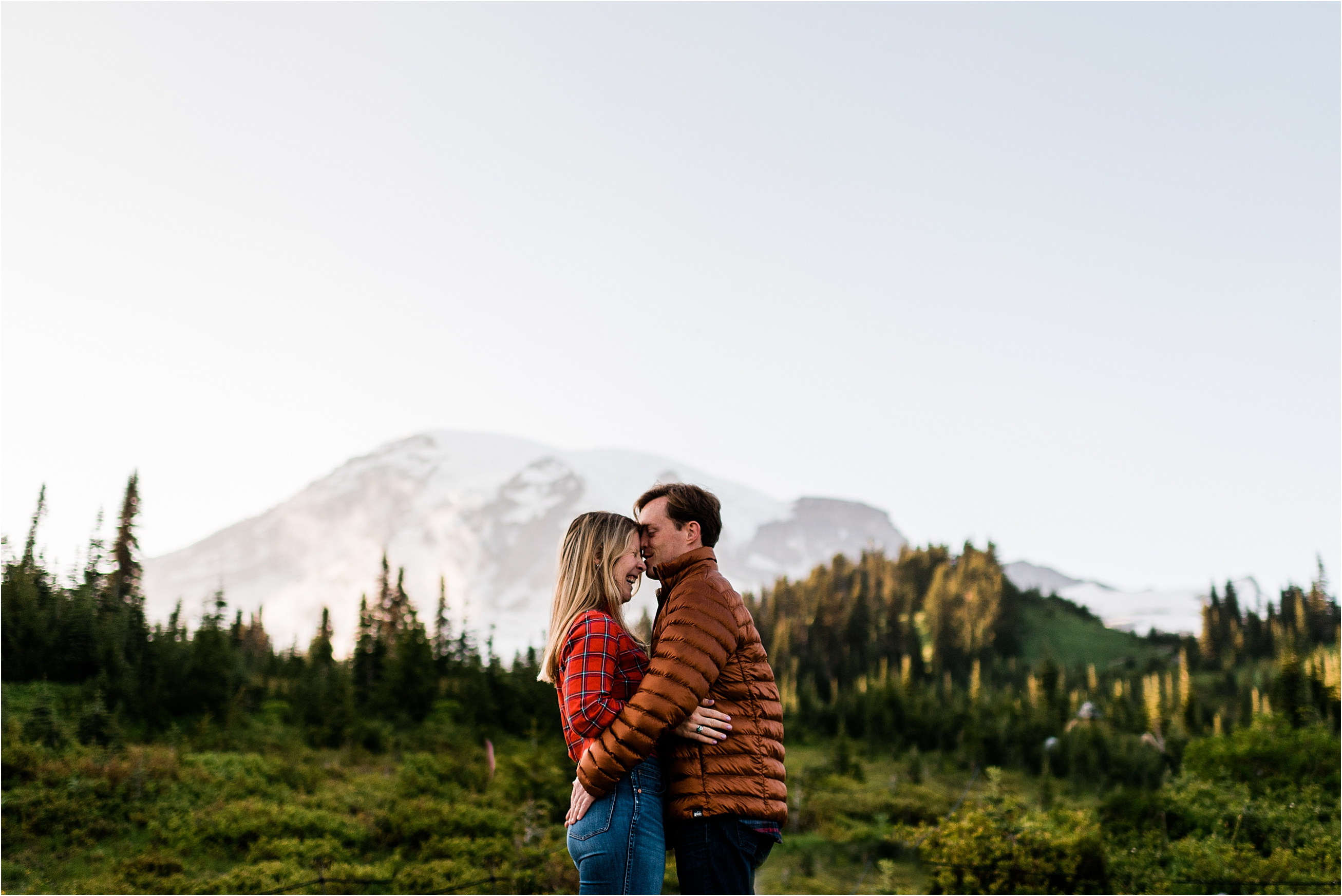 Kimi & Derek's backpacking engagement session at Mount Rainier, with Rainer at sunset in the background. Image by Forthright Photo.