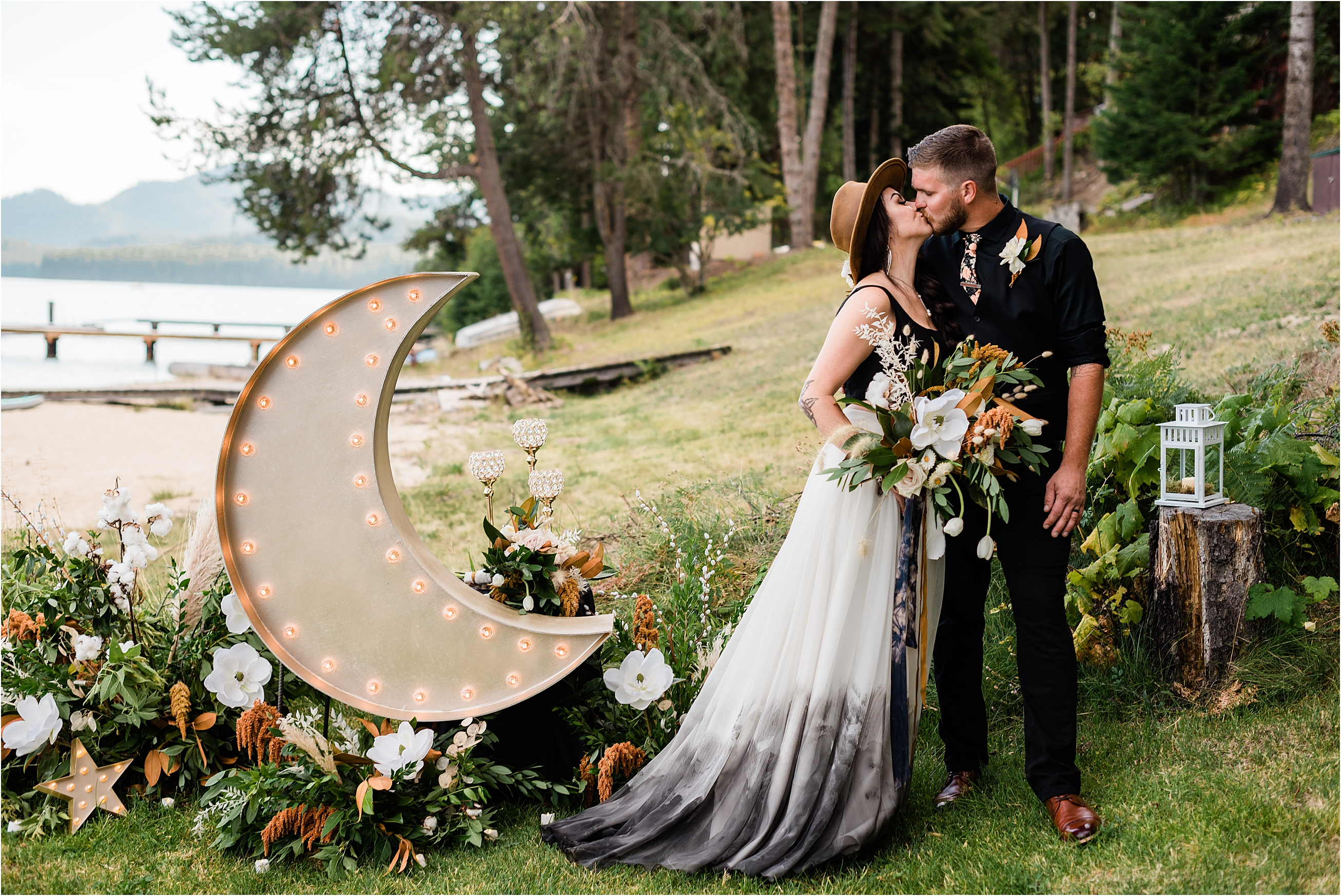 Shelby & Garrett and their custom made celestial inspired moon decor at the autumn Priest Lake elopement.
