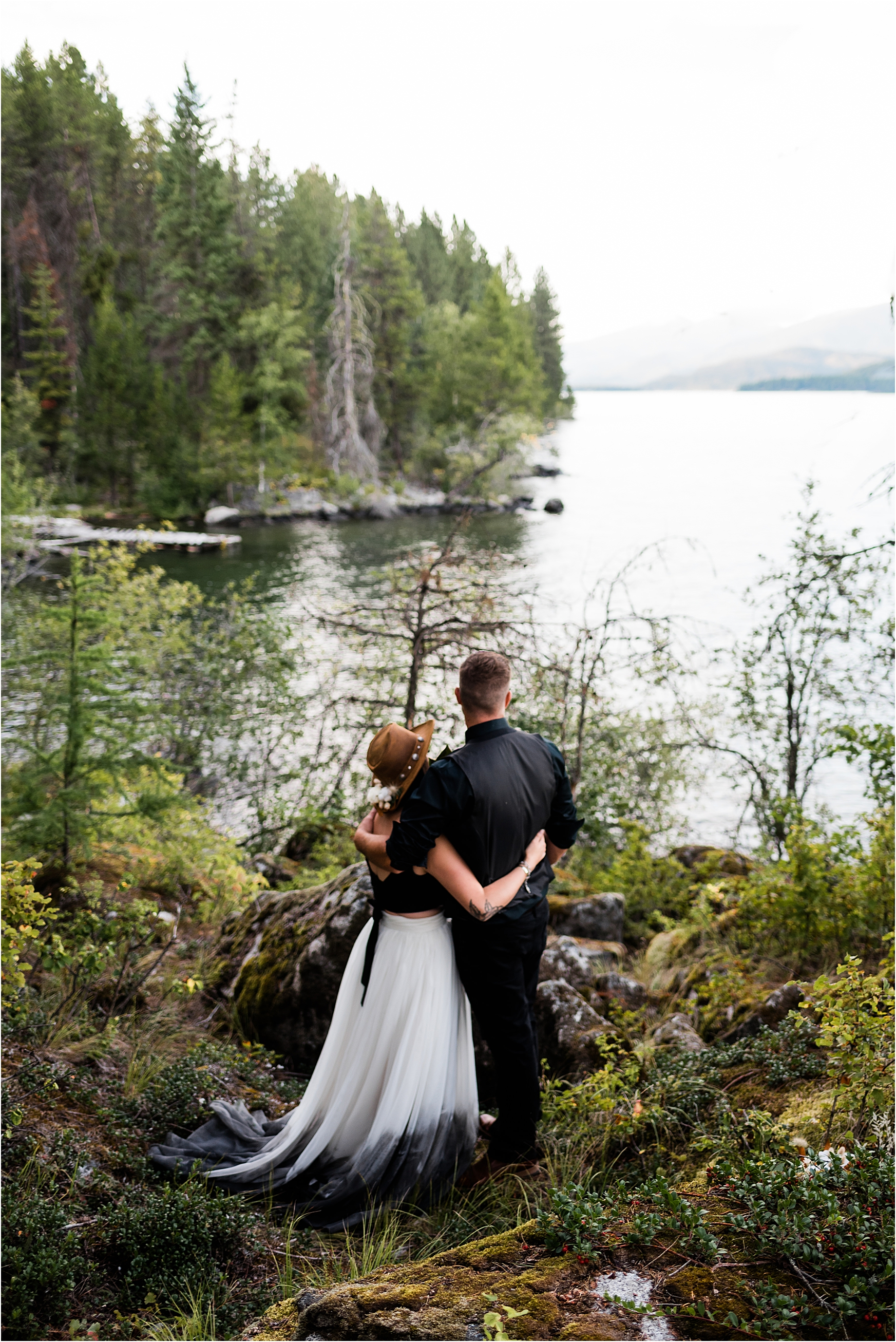 Shelby & Garrett walking through the woods around Priest Lake during their autumn elopement. Image by Forthright Photo.