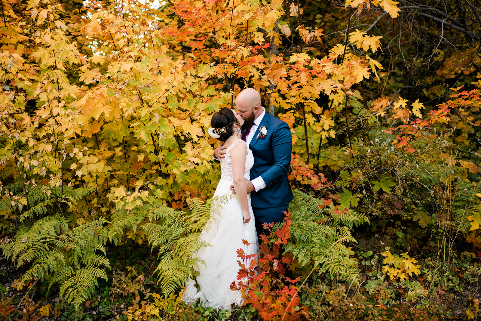 Fall foliage bridal portraits. Boho, Fall Mountain wedding in Leavenworth at Brown Family Homestead. Image by Forthright Photo.