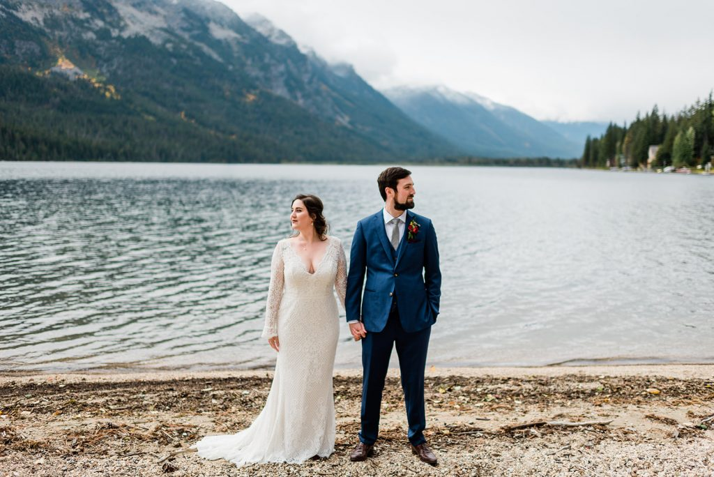 Jamie & Wilson's first look on  Lake Wenatachee at their Leavenworth wedding. Image by Forthright Photo