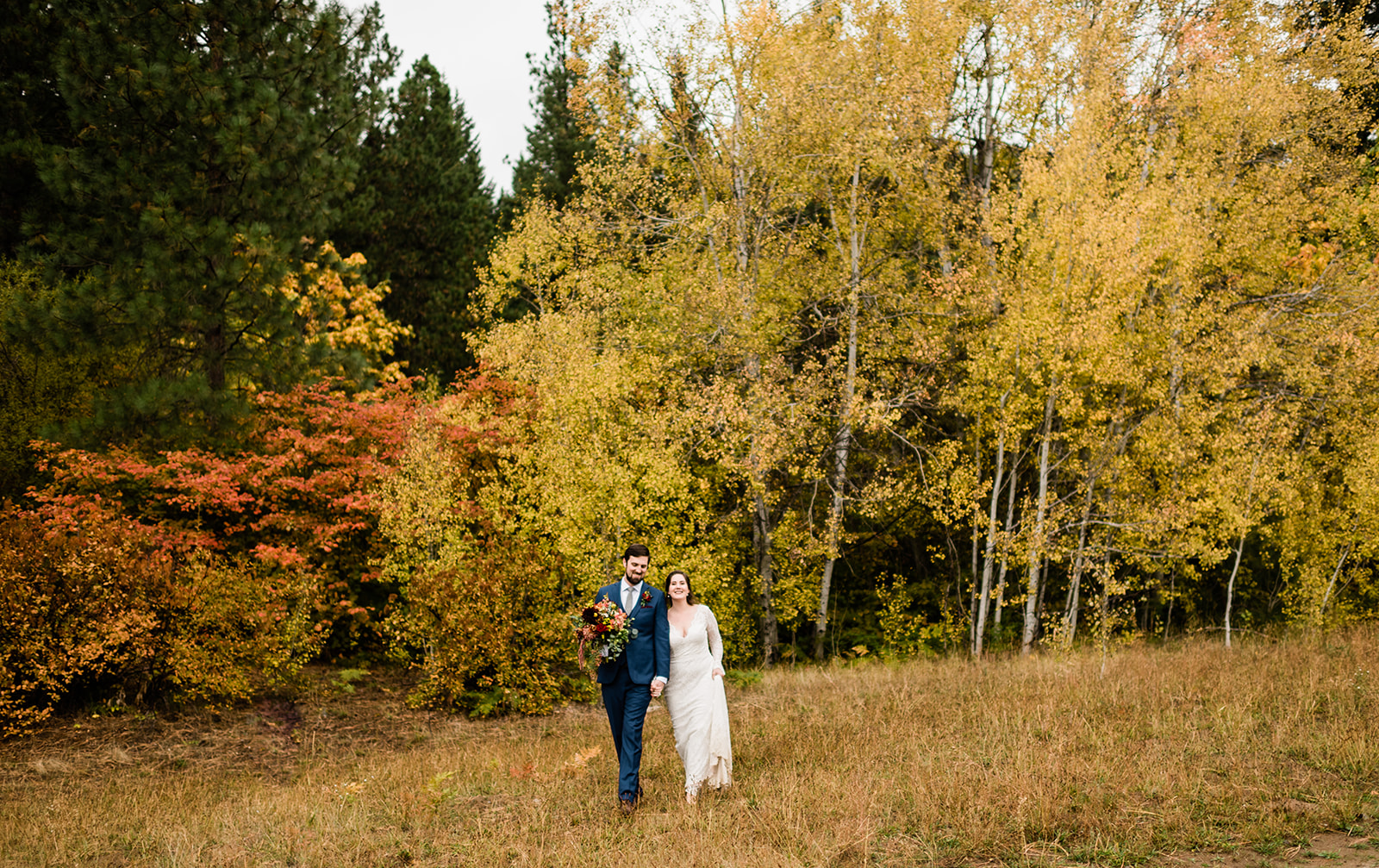 Jamie & Wilson at their colorful fall Leavenworth wedding at Brown Family Homstead. Image by Forthright Photo, Seattle wedding photographers