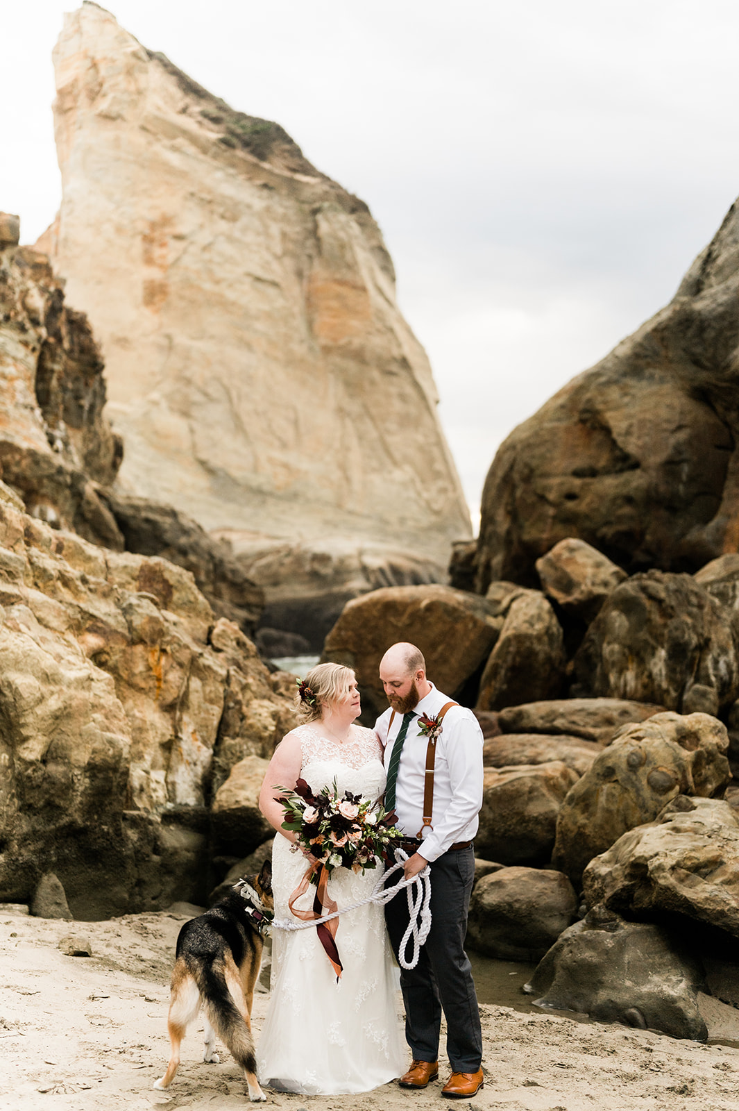 Amber & Russell's autumn elopement at Cape Kiwanda, Oregon. Image by Forthright Photo.
