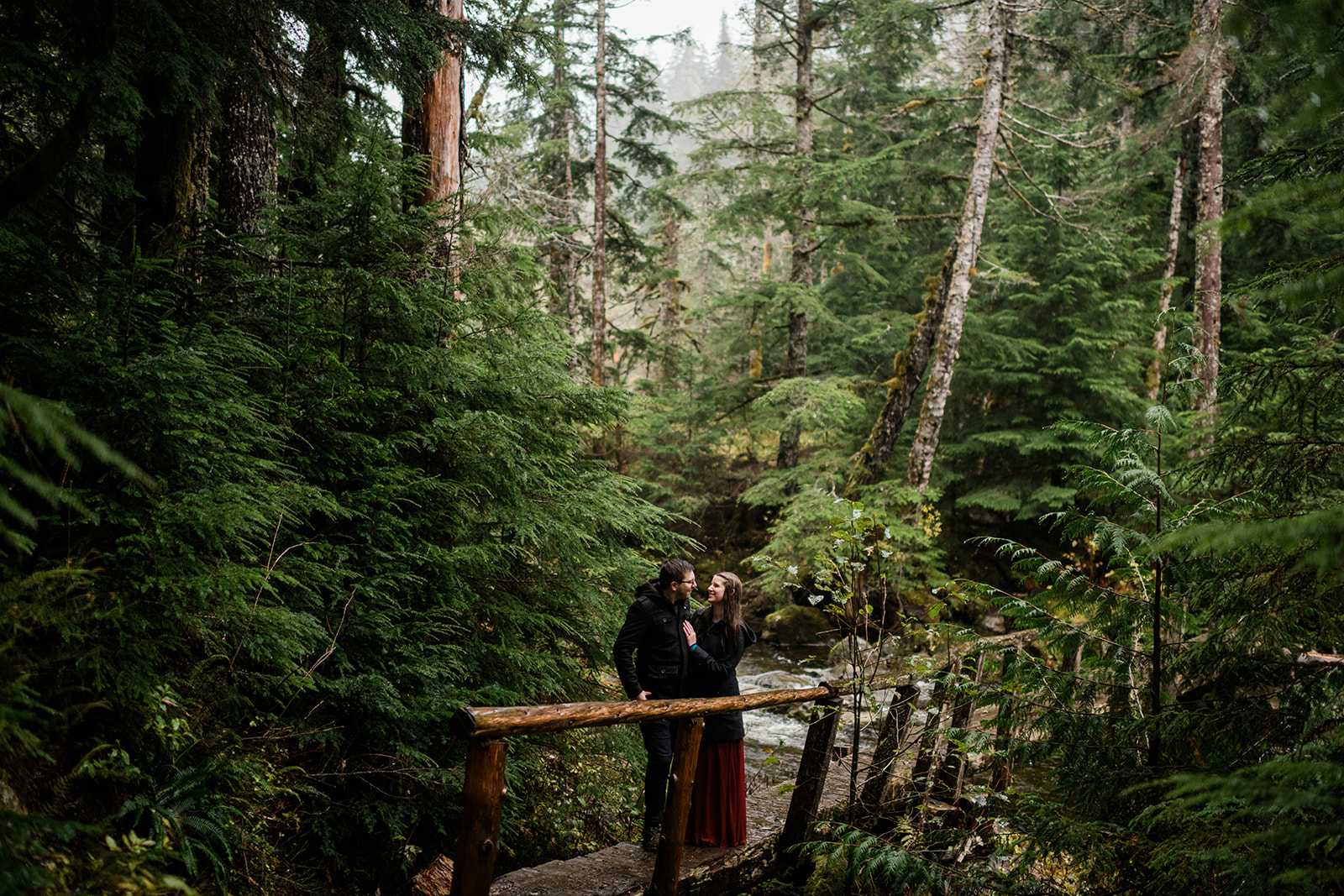 Rainy, moody, mountain lake cloudy PNW engagement photo. Image by Forthright Photo.